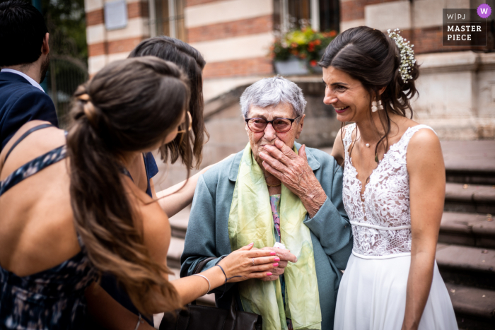 Carmaux Town Hall nuptial day award-winning image of an Emotional moment of the brides grandma after the ceremony