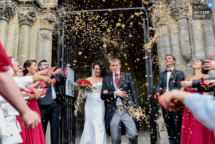 France nuptial day award-winning image of The family that throws wheat at the bride and groom