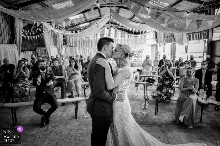 Humble by Nature, Upper Meend Farm, Monmouth indoor marriage ceremony award-winning image showing the First kiss as Mr and Mrs