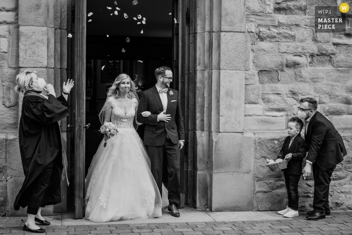 Dortmund nuptial day award-winning image of the flower confetti when the wedding couple leaves the church