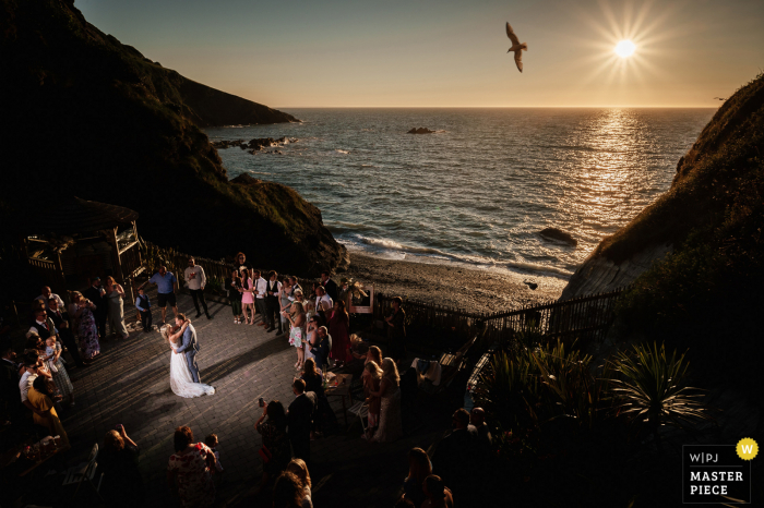 Tunnels Beaches outdoor marriage reception party award-winning photo that has recorded a sunset first dance by the ocean