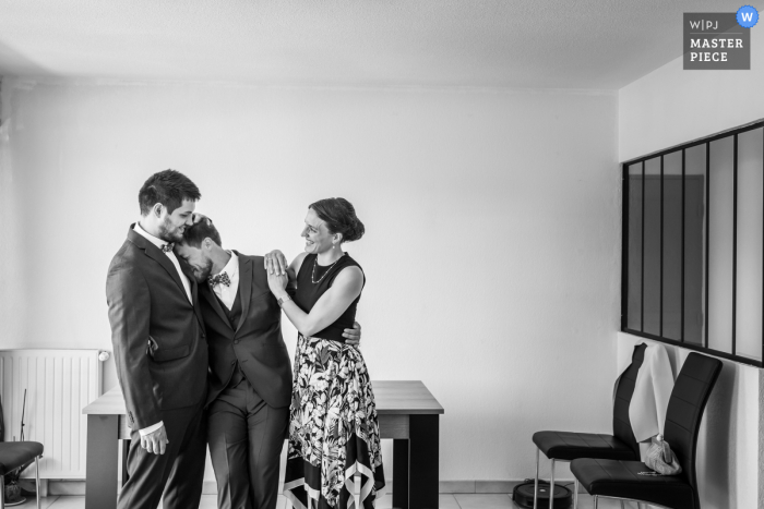 Gap, France marriage preparation time award-winning picture capturing the Groom with family getting ready