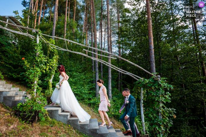Raiski Zaliv, Goliama Zheliazna, Bulgaria outdoor marriage award-winning image showing The Bride on her way to the Ceremony