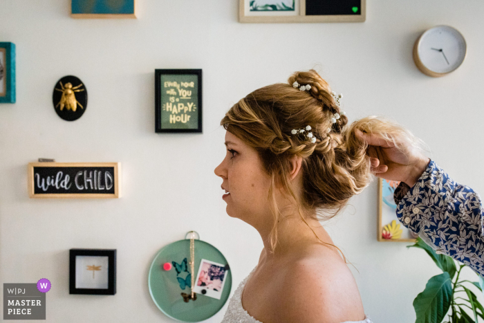Eeklo marriage preparation time award-winning picture capturing the bride getting her hair fixed. The world's best wedding image competitions are held by the WPJA