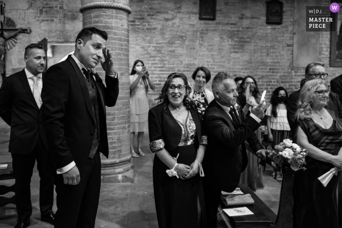 Siena indoor marriage ceremony award-winning image showing a tear wipe in black and white. The world's best wedding picture competitions are featured via theWPJA