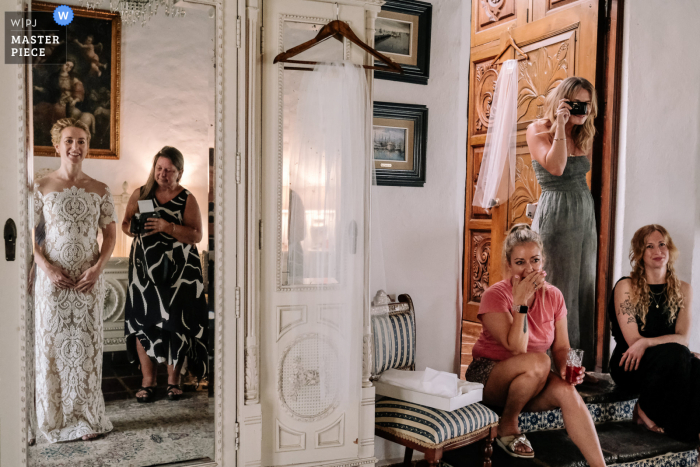 Hacienda Acamilpa marriage preparation time award-winning picture capturing the Bride ready, surrounded by friends. The world's best wedding image competitions are held by the WPJA