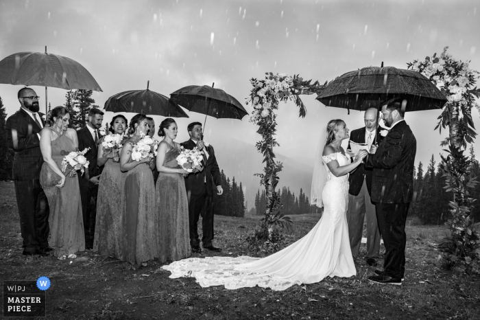 Timber Ridge Lodge, Keystone outdoor marriage ceremony award-winning image showing The ceremony getting deluged by heavy rain, causing it to get cut short