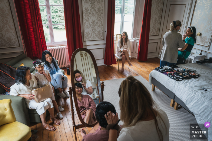 Le Cellier, France marriage preparation time award-winning picture capturing Getting ready for the bridal party. The world's best wedding image competitions are held by the WPJA