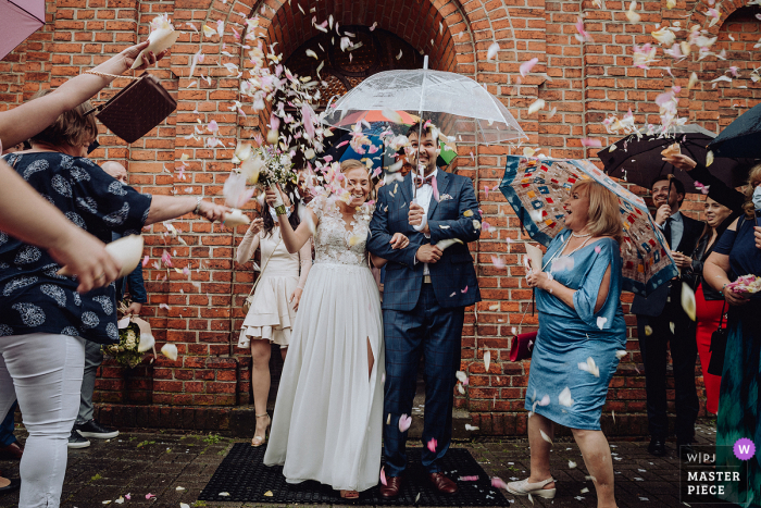 Warsaw nuptial day award-winning image of Flowers everywhere. The world's best wedding photography competitions are hosted by the WPJA