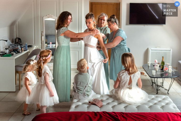 Lille marriage preparation time award-winning picture capturing preparations for the bride with her witnesses and children. The world's best wedding image competitions are held by the WPJA