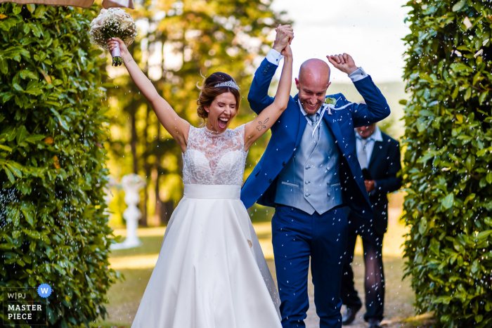 Castello Formentini, San Floriano del Collio, Gorizia nuptial day award-winning image of the Confetti moment during outdoor departure - from the world's best wedding photography competitions hosted by the WPJA