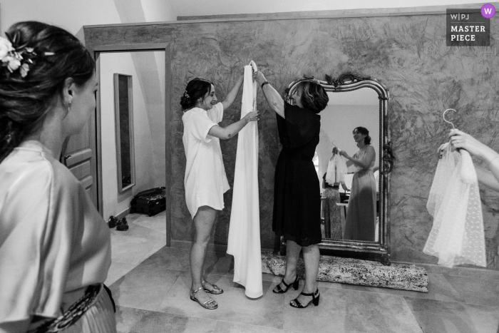 Paris getting ready for marriage award-winning picture capturing The bride about to get dressed - from the world's best wedding photography competitions held by the WPJA