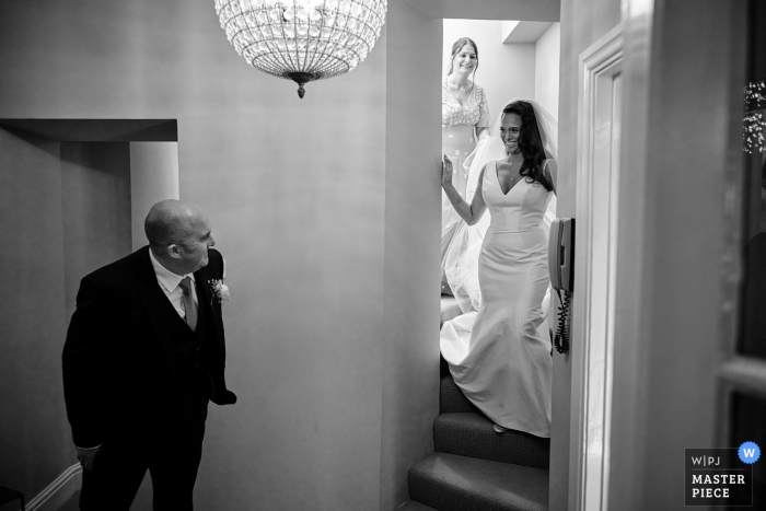 Compton Verney getting ready for marriage award-winning picture capturing the Father seeing his daughter for the first time in her dress - from the world's best wedding photography competitions held by the WPJA