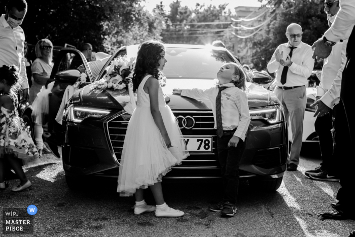 Bursa nuptial day award-winning image of the young guests leaning on a nice car - from the world's best wedding photography competitions hosted by the WPJA