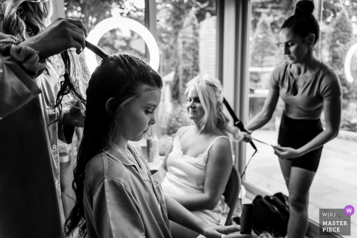 Philadelphia getting ready for marriage award-winning picture capturing The bride and her daughter getting their hair done simultaneously - from the world's best wedding photography competitions held by the WPJA
