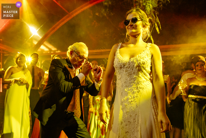 O Butiá - Porto Alegre marriage reception party award-winning photo that has recorded the Bride dancing in style with her uncle - from the world's best wedding photography competitions offered by the WPJA