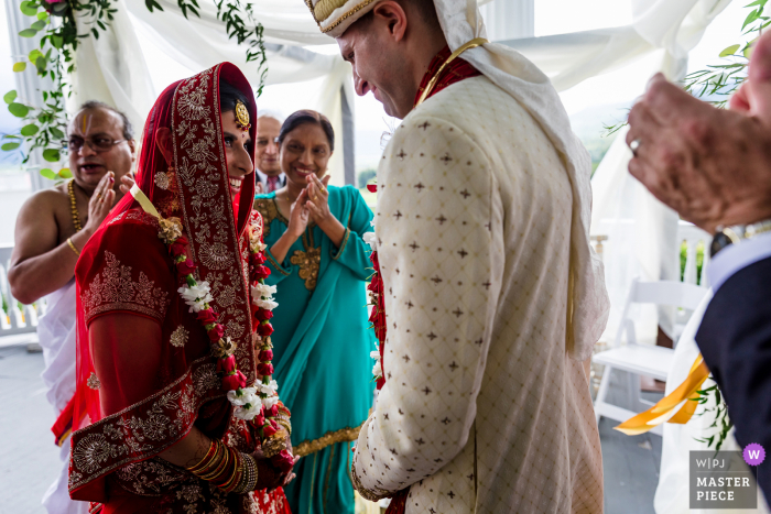 Omni Mount Washington Resort in Bretton Woods New Hampshire marriage ceremony award-winning image showing The couple seeing each other for the first time at their Hindu wedding - from the world's best wedding photography competitions presented by the WPJA