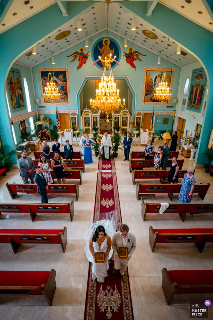 St. Andrew Ukrainian Orthodox Cathedral, Maryland marriage ceremony award-winning image showing An aerial view of the couple exiting the church - from the world's best wedding photography competitions presented by the WPJA