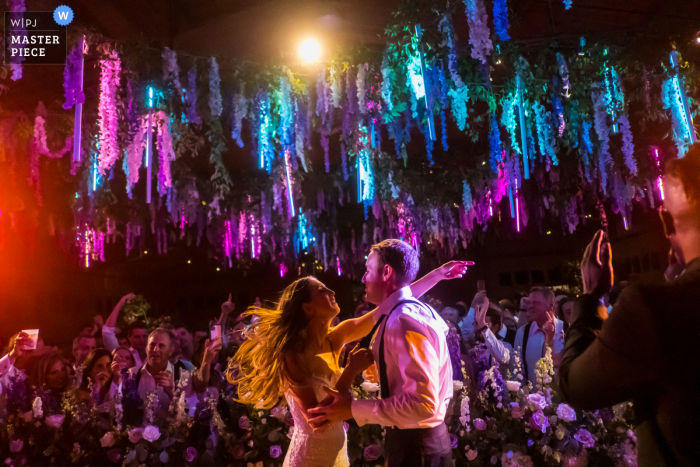 Chapperral Ranch Aspen, Colorado marriage reception party award-winning photo that has recorded The bride and groom dancing on the bands stage at the end of the reception - from the world's best wedding photography competitions offered by the WPJA