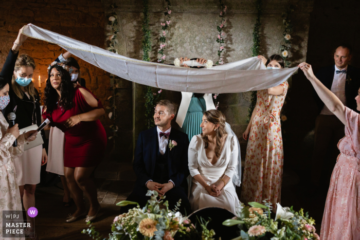 France marriage ceremony award-winning image showing a Traditional Iranian vow exchange - from the world's best wedding photography competitions presented by the WPJA