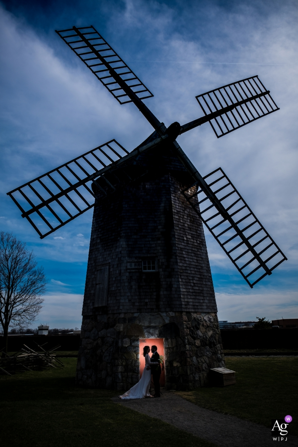 Evening silhouette wedding portrait of the couple lit in the doorway of a windmill at Greenfield Village, Michigan | The Henry Ford Museum - Dearborn, MI