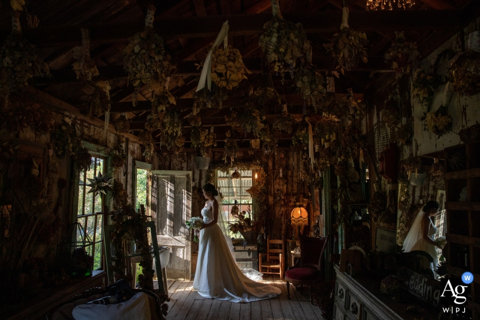 Park Winters, Winters, CA wedding photographer | A bride posed in a room full of dried flowers with her mirror reflection