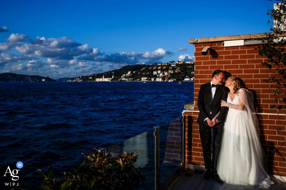Istanbul, Bosphorus Palace wedding couple posing for portraits at Istanbul