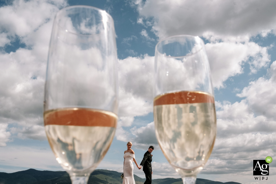 Hotel Antonieta, Oaxaca wedding venue photography. The Bride and groom framed in their champaign glasses