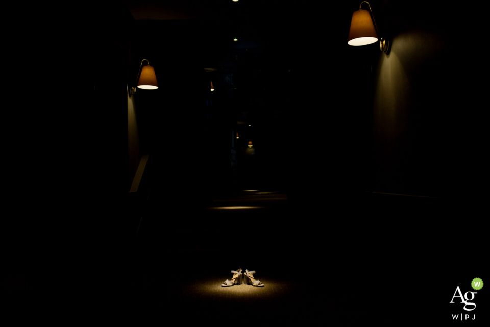 """Avon Gorge, Hotel du Vin wedding detail pictureby Bristol wedding photographer """"I noticed dramatic light on the hotel corridor next to the bridal suite, so I pleased bride's shoes under the spotlight"""""""
