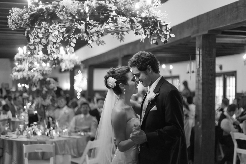 Williamsburg Winery wedding photographer covering the first dance with the bride and groom.