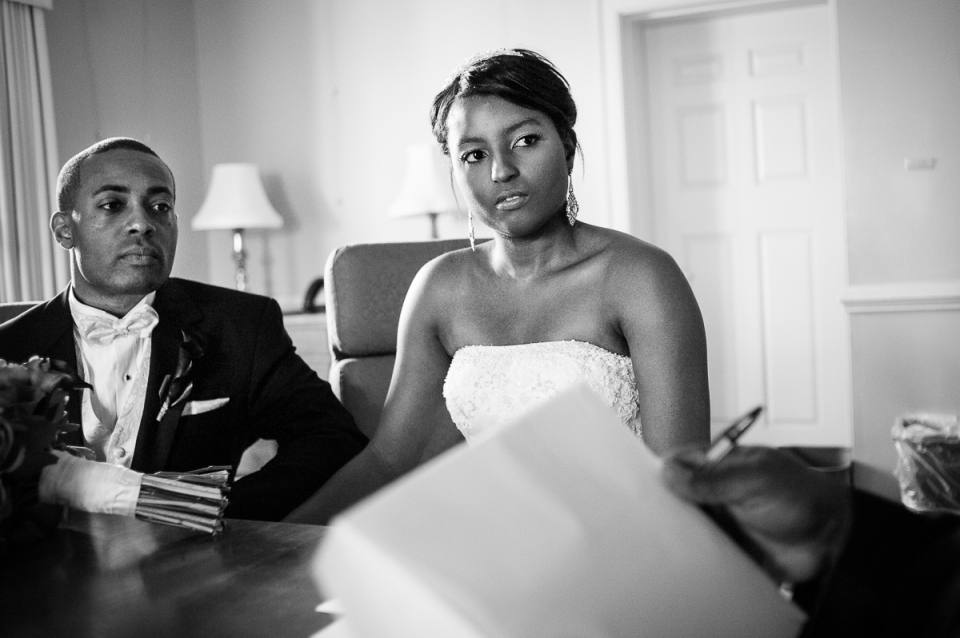 Bride and groom awaiting marriage license during wedding at The Mansion at Strathmore, Rockville, MD