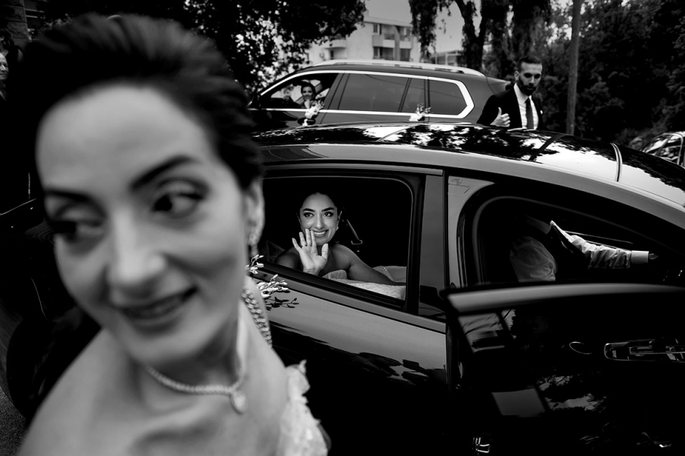 Lebanon Wedding Photography in Beirut | Black and white image of the Bride in the car with a bridesmaid