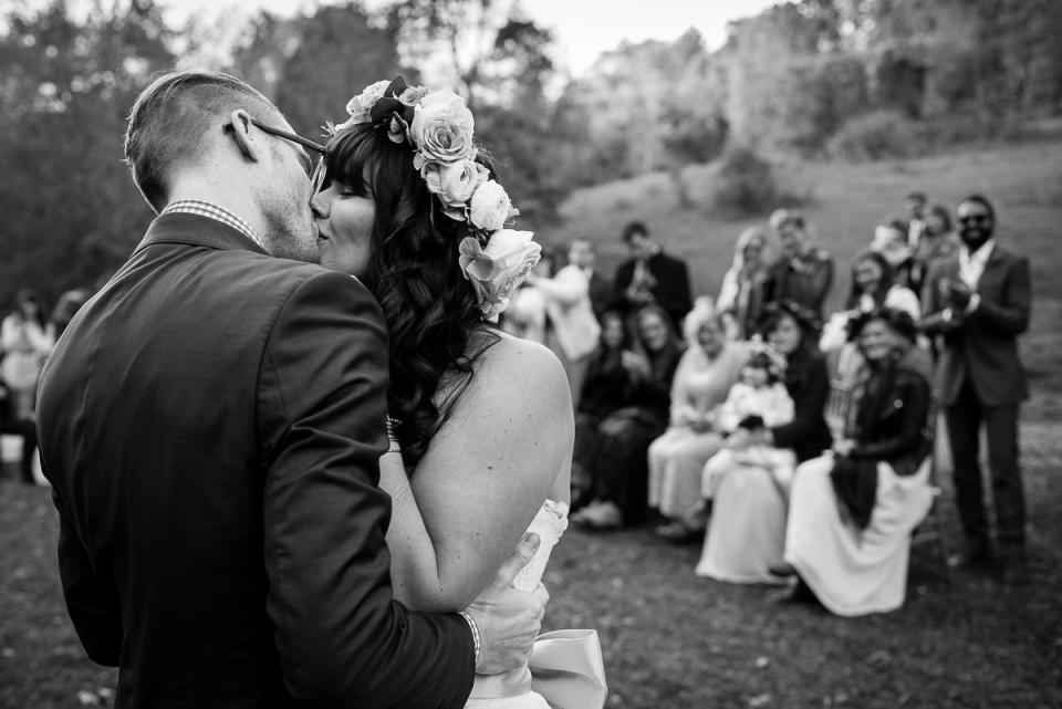Wedding couple kiss at country wedding near Blacksburg, Virginia.