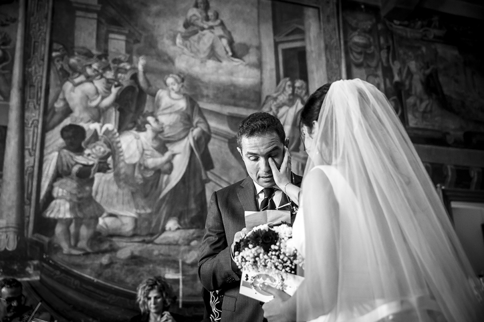 Rome Tivoli Town Hall Wedding Photography of the bride wiping a tear for the groom during the ceremony