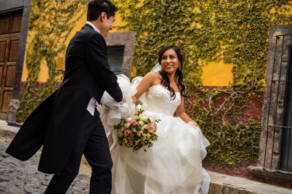 San Miguel de Allende Guanajuato wedding image of the bride and groom walking at Hotel Imperio de Los Angeles