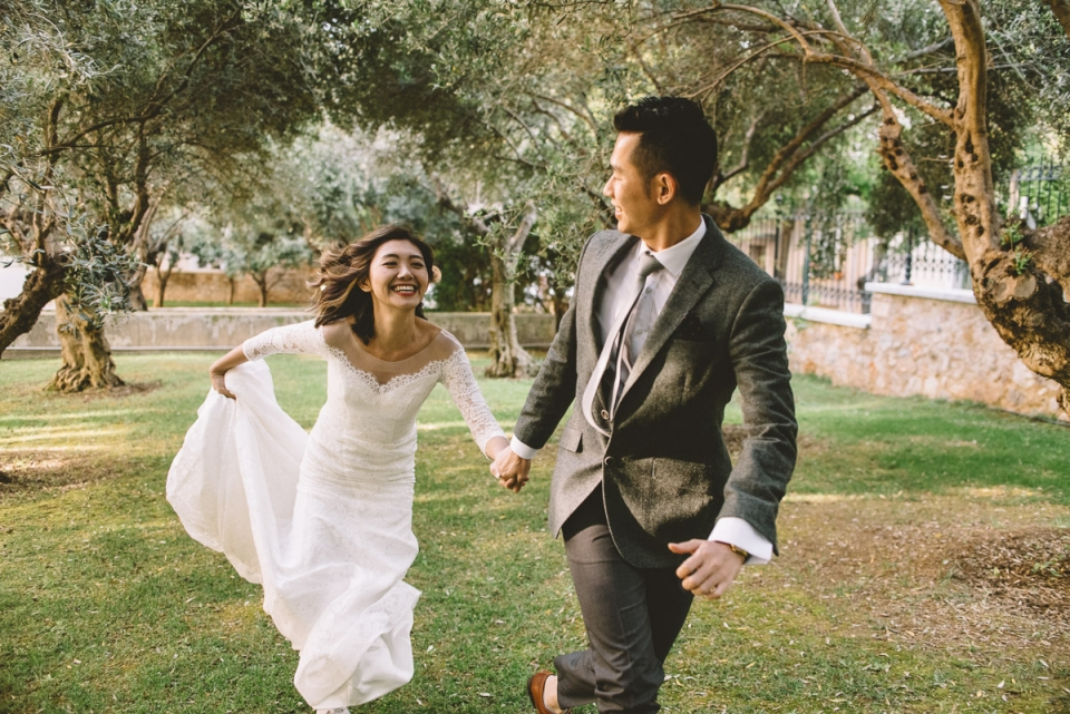 Photo of Saint George Lycabettus newlywed wedding couple running smiling
