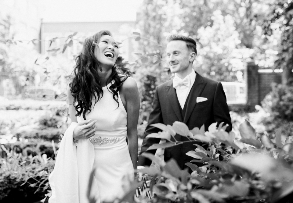 American Swedish Historical Museum Wedding Photograph of bride and groom laughing in black and white