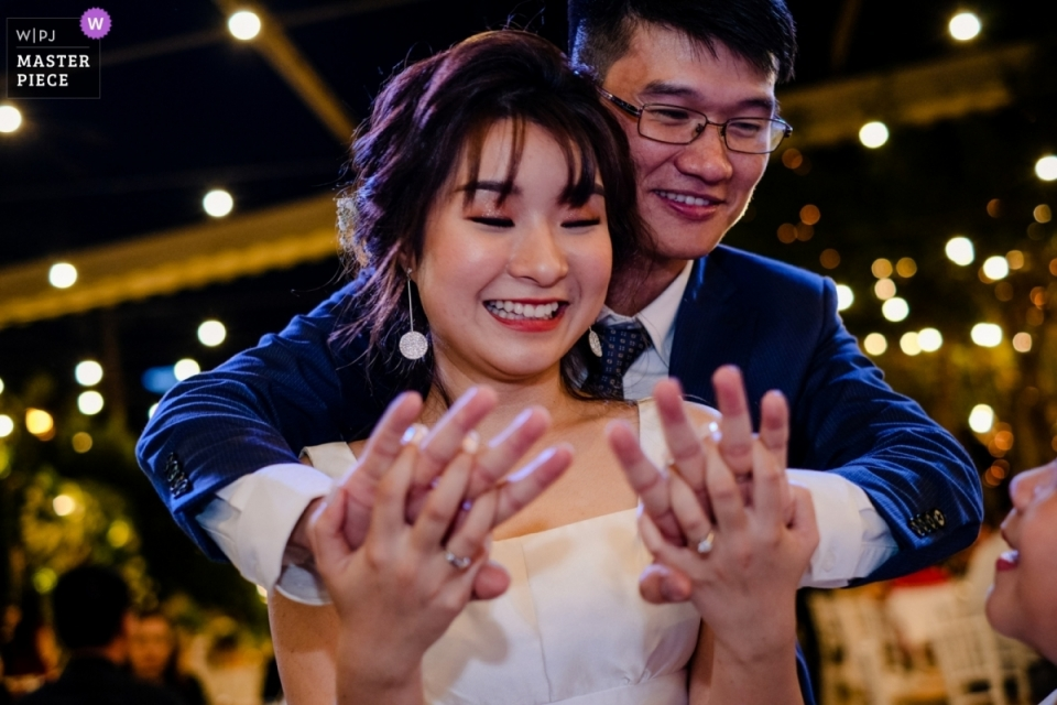 Ho Chi Minh City wedding reception photograph of bride and groom holding hands on the dance floor