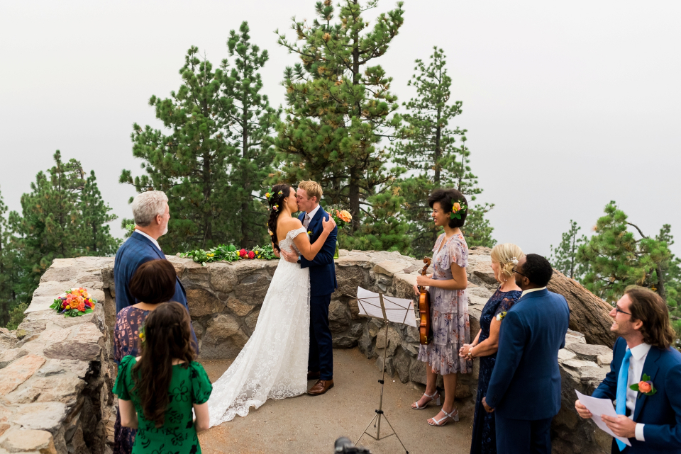 Intimate wedding ceremony image from a private, family Elopement - Photo by Lauren Lindley