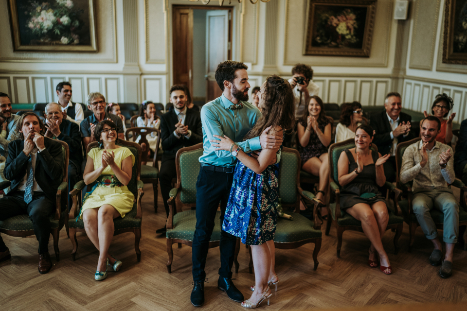 Wedding image of the bride and groom about to kiss at a Lyon, France Town Hall Civil Ceremony - Elopement Photo by Audrey Morisson