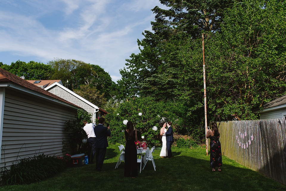 Outdoor wedding ceremony image from a Norwalk, Connecticut Backyard Elopement - Photo by Korri Crowley