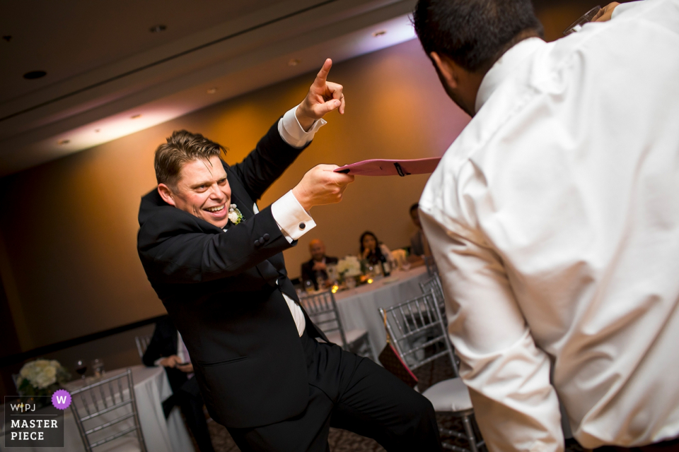 Groom dancing at the wedding reception at the Hotel Valencia in San Jose, California