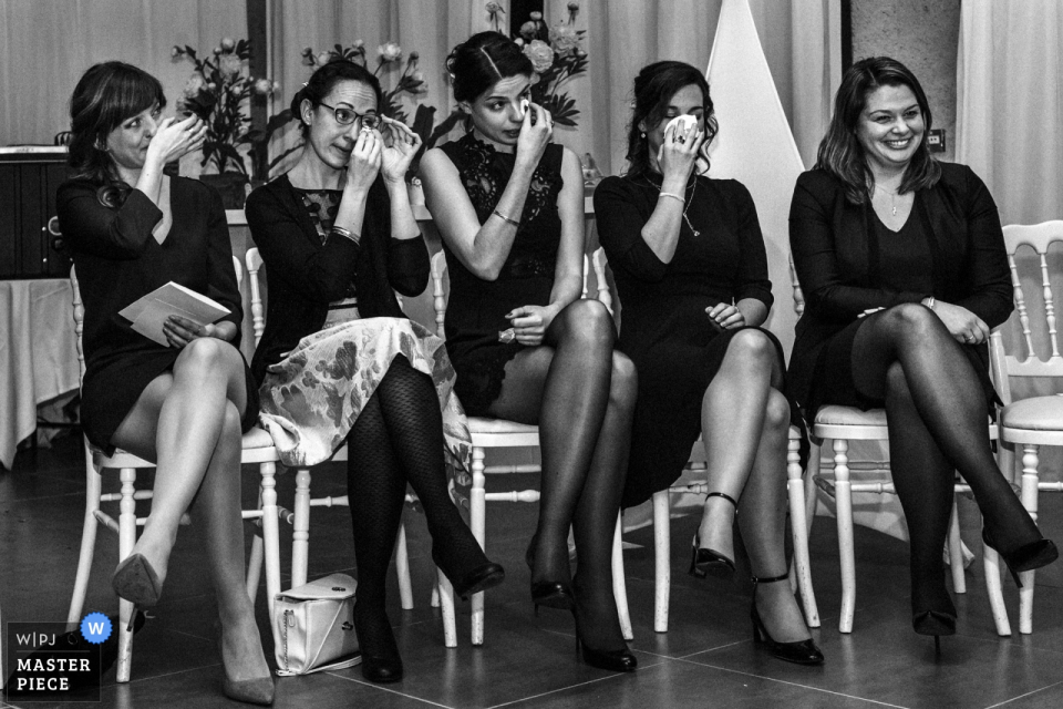 La Ferme du Grand Chemin bridesmaids get emotional sitting in chairs at the wedding ceremony