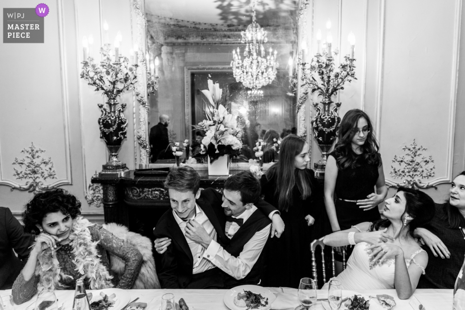 Bridal party talking to each other at the wedding reception in Paris, Maison des Polytechniciens