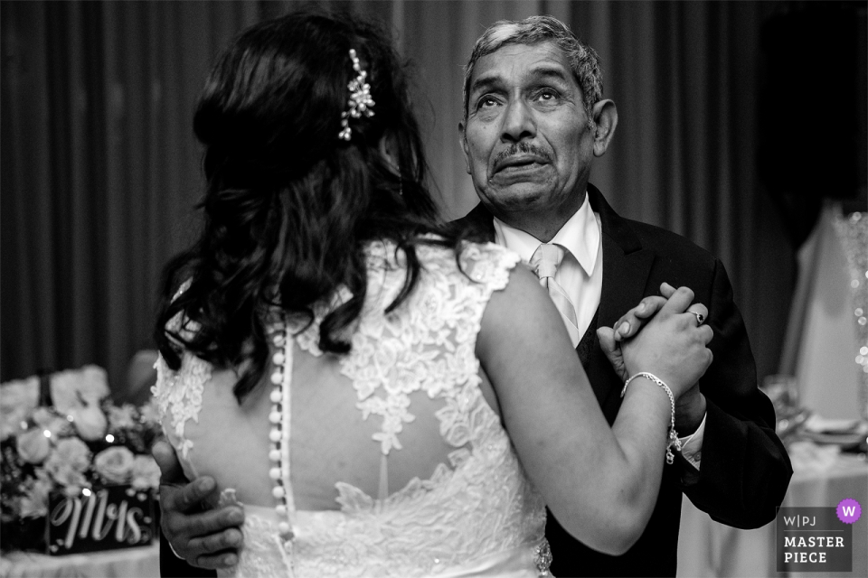Brides father gets emotional while dancing with her at the wedding reception at the Atlantis Casino Reno, NV