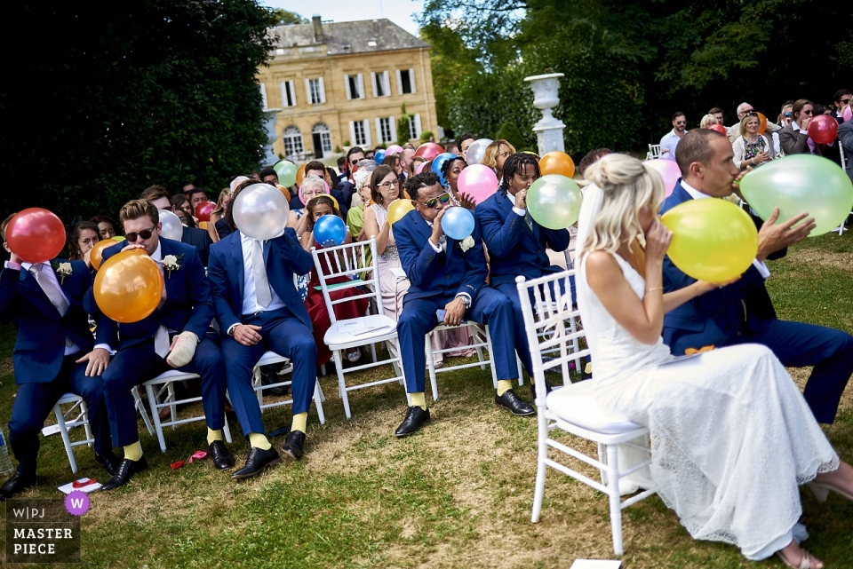 Balloons blowing up during wedding ceremony at Chateau la Durantie FRANCE