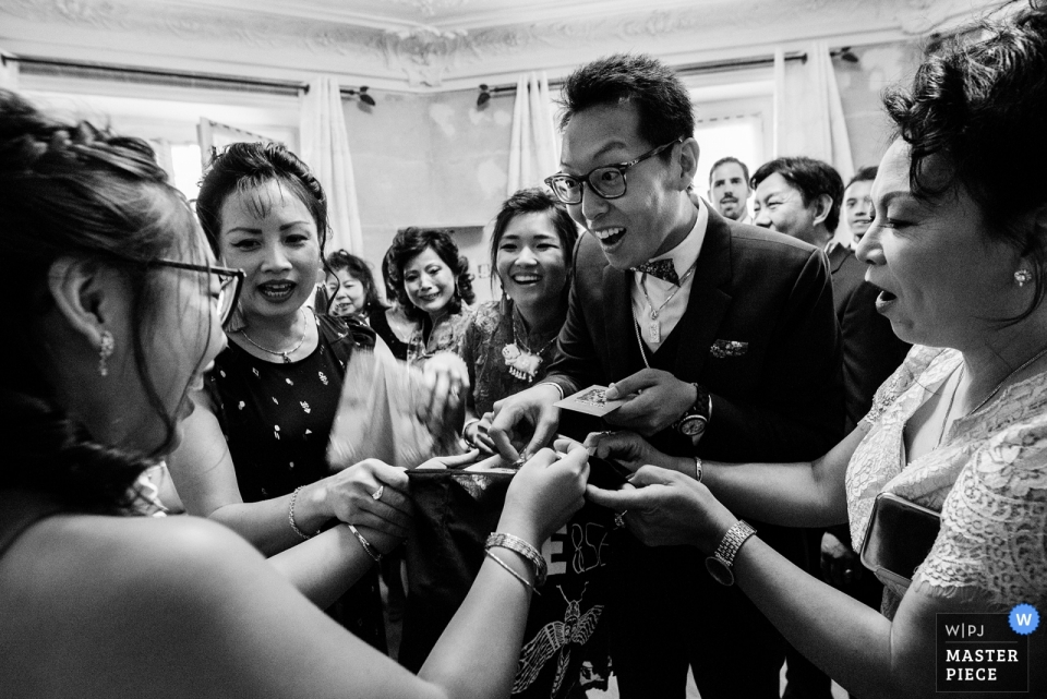 Chateau de Meridon Paris wedding photograph of the groom surrounded by women.