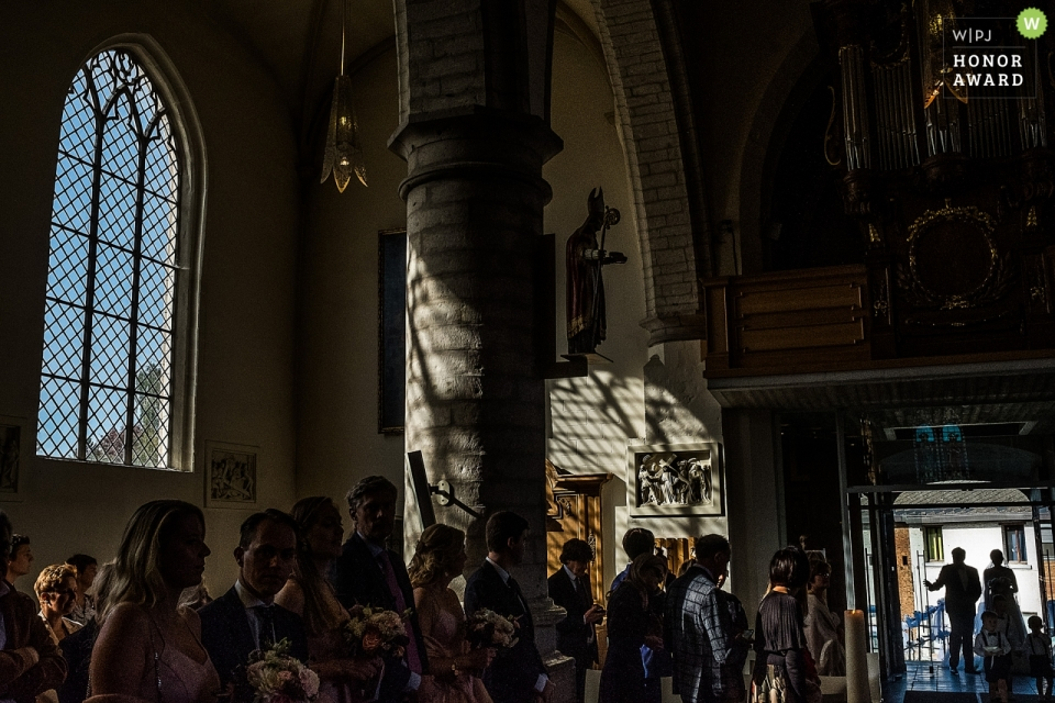 Guests get ready to greet the newlywed couple - Chateau de l'Ardoisière wedding photography