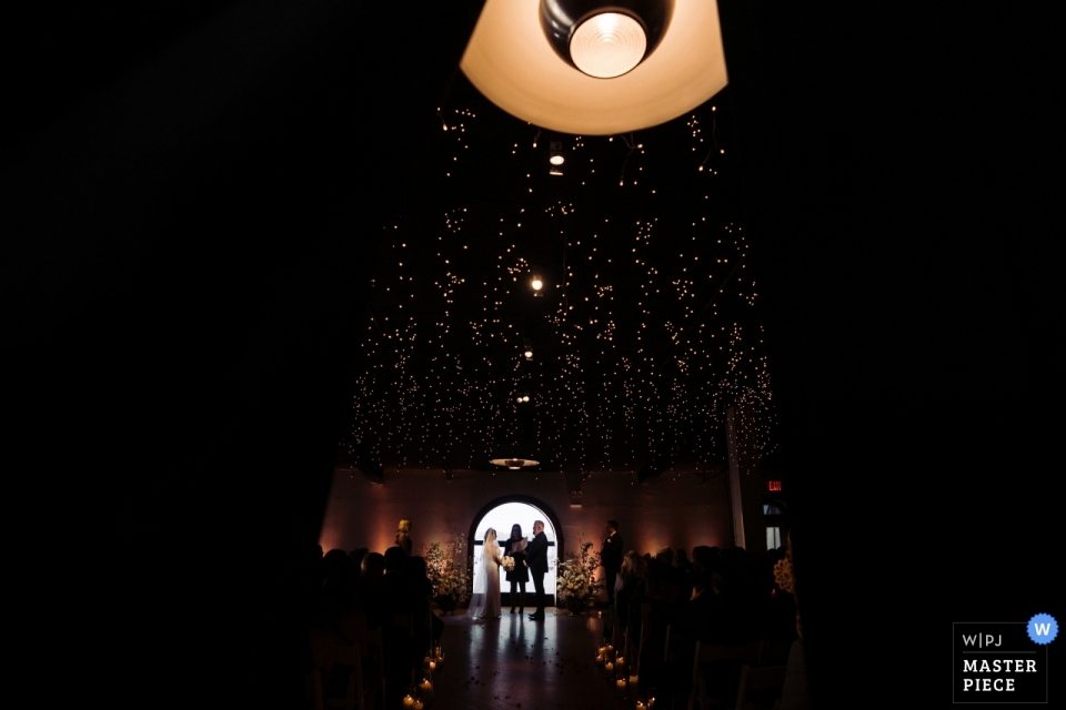 The Liberty Warehouse, Brooklyn, NY wedding photographer | photograph from behind curtain during wedding ceremony