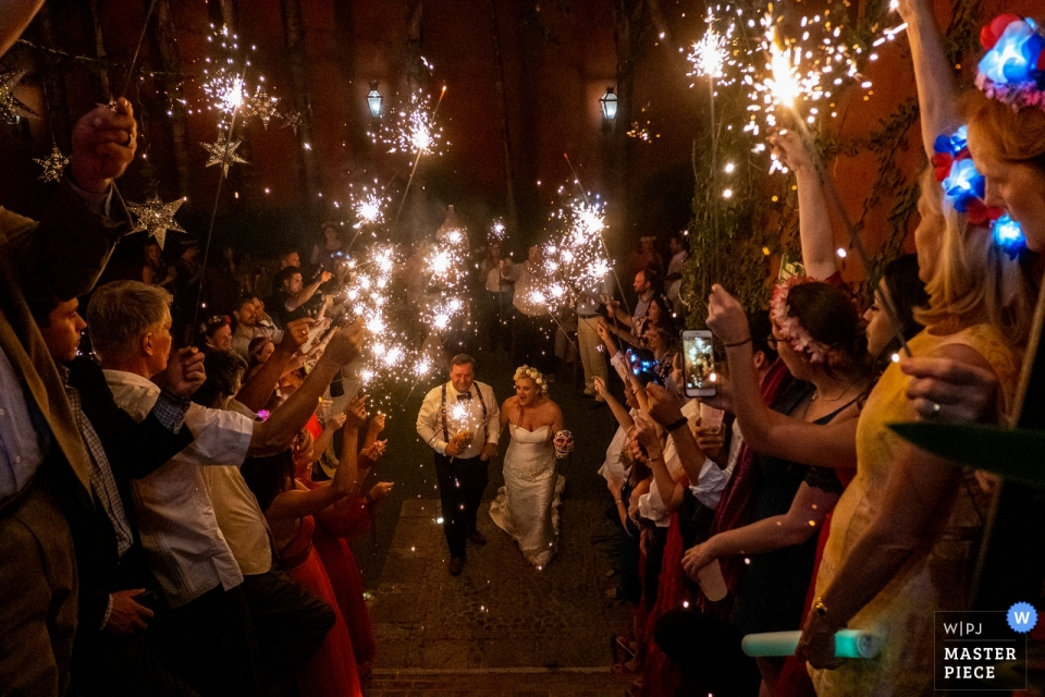 casa hyder, san miguel de allende, mexico wedding photography   the bride and groom exit their reception with sparklers